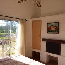 Dormitorio Principal con hogar a leña
