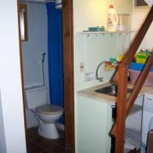 Baño y lavadero de servicio